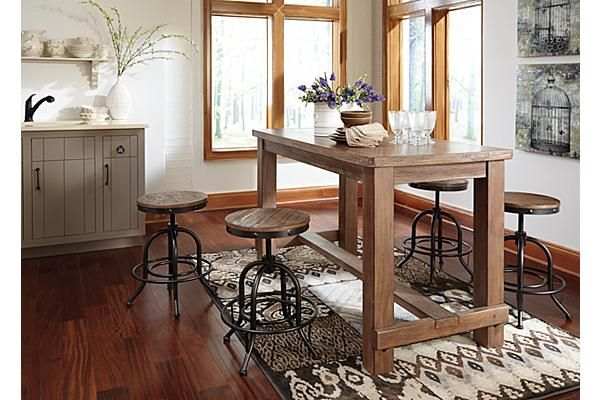 The pinnadel counter height dining room table from ashley for Dining room sets with matching bar stools