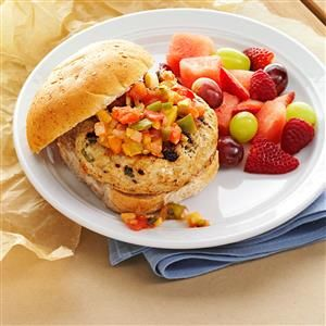 Turkey Burgers with Mango Salsa Recipe -This cookout recipe always has everyone talking. The secret is mixing a creamy, spreadable cheese into the turkey patties. It gives them lots of flavor without overpowering the burger. —Nancee Melin, Tucson, Arizona