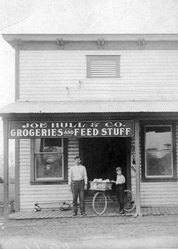 Florida Memory - Postcard showing the Joe Hull & Co. groceries and feed stuff store in Plant City, Florida.