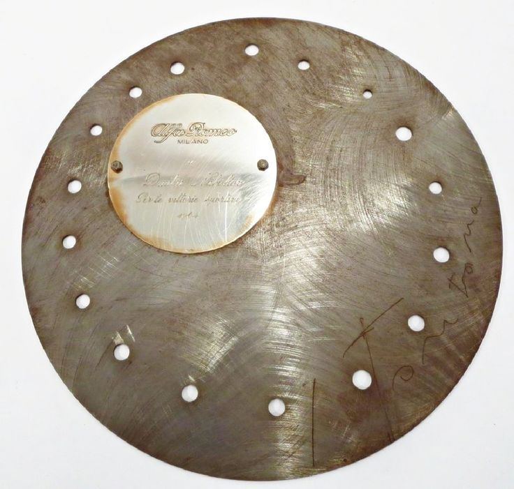 """Discus"" Commissioned by Alfa Romeo, Signed, with engraved plaque for Dmitri Nabokov (son of Vladimir Nabokov), 1964  Steel Disk (Hand Signed by Lucio Fontana, with engraved plaque to Nabokov) Lucio Fontana for Alfa Romeo"