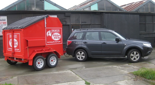 6 cubic metre skip bin on a car.