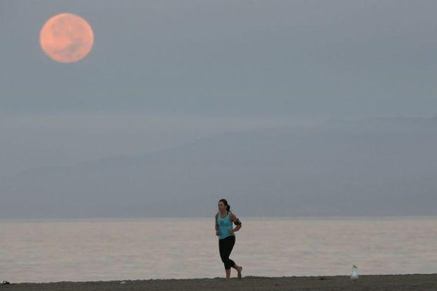 Blood moon and jogger Santa Monica, California