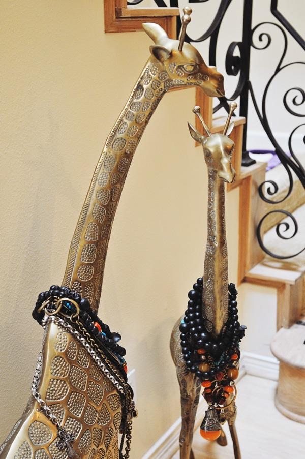 brass giraffes wearing jewelries