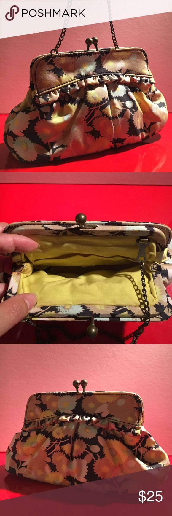 GAP clutch/mini purse Cute subtle ruffles in neutrals and pastels this purse can be used as a clutch or purse. Has a granny snap closure with buttercup yellow interiors and a pocket! Made of silk with cotton lining. The metal chain can be hidden inside or used- it's about 8' long. *probably over a decade old 😎 make me an offer 😎 GAP Bags Mini Bags