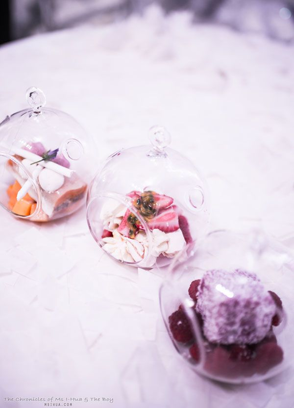 Fill glass ornaments with individual desserts for an elegant dessert display. #LivingGrand | Grand Hyatt
