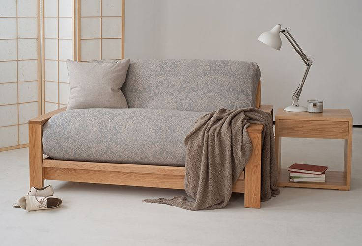 Panama oak sofa bed base with 6layer futon in a new wool cover. Shown with our new side table in oak. All exclusive to Natural Bed Company.  http://www.naturalbedcompany.co.uk/shop/sofa-beds/panama-futon-sofa-bed/