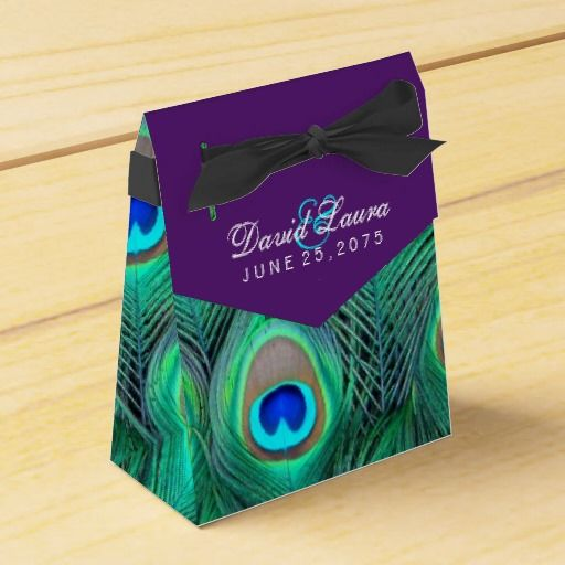 Elegant plum purple and vibrant emerald green, royal blue and teal blue peacock feather wedding favor boxes. You can change the bow color, add text in the font style, size and color of your choice on this beautiful plum purple peacock wedding favor box.