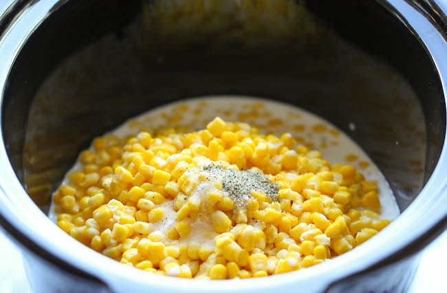 Slow Cooker Creamed Corn - So rich and creamy, and unbelievably easy to make with just 5 ingredients. Doesn't get easier than that!