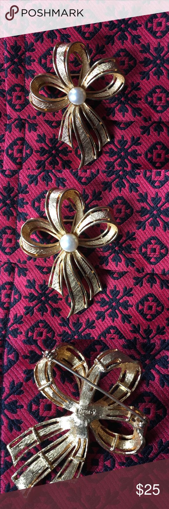 Vintage Napier Pearlescent Bow Brooche This classic Napier brooche is a classic spin on a bow pin. Classic and timeless Napier will never be out of style. High quality costume jewlery this will dress up any plain accessory. Brooche is in excellent working vintage condition, please refer to photos  for condition. All offers welcome Napier Jewelry