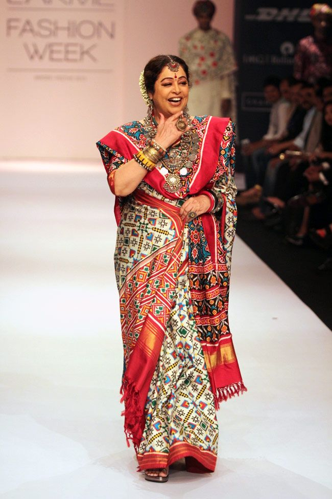 Veteran actress Kirron Kher walks the ramp in a white Patan Patola sari for designer Gaurang at the Lakme Fashion Week Winter-Festive 2013.