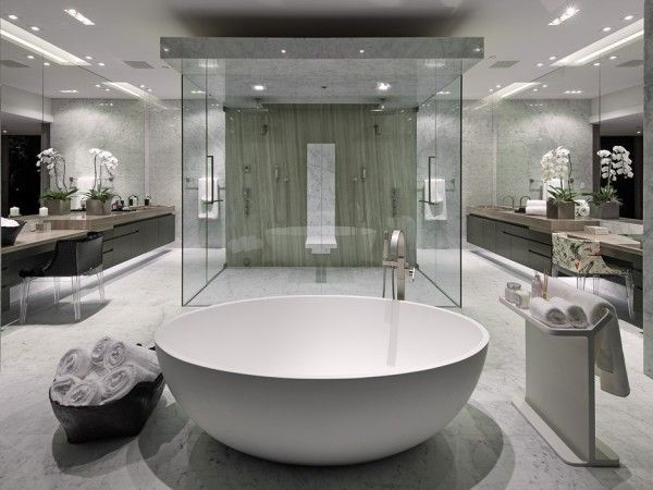 This huge master bathroom also has views overlooking the canyon. Inside the luxury suite, twin rainfall shower heads adorn the massive central shower cubicle, and twin vanity areas span each wall, almost creating a mirror image in the layout.
