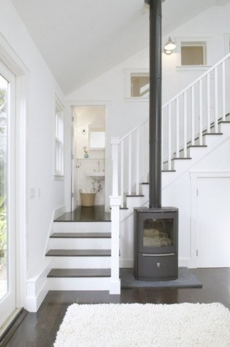 love the bath on the landing- which creates a small crawl space below stairs... hopefully the windows don't allow people on the stairs to peek at the person in the bath! :)