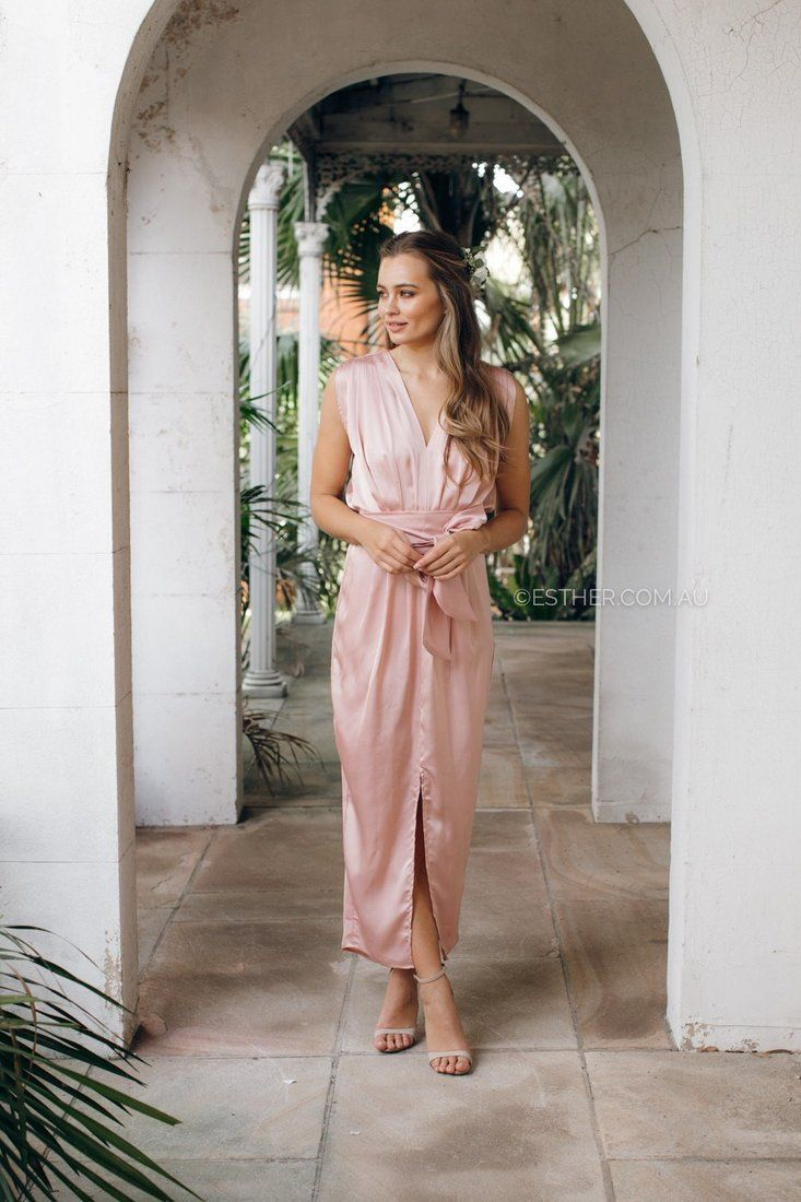 The Athens Blush Maxi Dress features a wrap over maxi dress shape suits all figures, and a pretty tulip hemline is cut to show off embellished sandals or strappy heels. Pleated effects and an elasticated waistband streamline the contours.