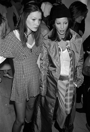 Carla Bruni and Christy Turlington backstage at the Marc Jacobs for Perry Ellis Spring 1993 show.