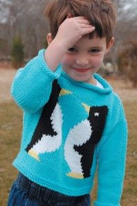 Knitting pattern for child's pullover sweater with two penguins