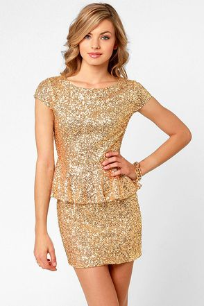 AS SEEN IN PEOPLE STYLEWATCH and on Jas of For All That Jas blog! We'd like to make a toast to the Champagne Dame Brilliant Gold Sequin Dress with its darling peplum waistline and impressive sense for sequins! Tiny gold sequins glitter from cute cap sleeves and scoop neckline into a fitted skirt that's just begging for the perfect pumps. Hidden side zipper. Fully lined. Model is wearing a size x-small. 100% Polyester. Hand Wash Cold. Imported.