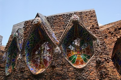 Guell Crypt designed by Antoni Gaudi started in 1908 and finished in 1914 love the irregular shaped windows an stunning glass works