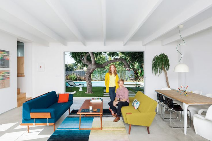 The Los Felix residence of Glee star Jayma Mays and actor Adam Campbell is a colorful, modern retreat that makes the most of the warm Los Angeles climate with a living room that opens to the outdoors.