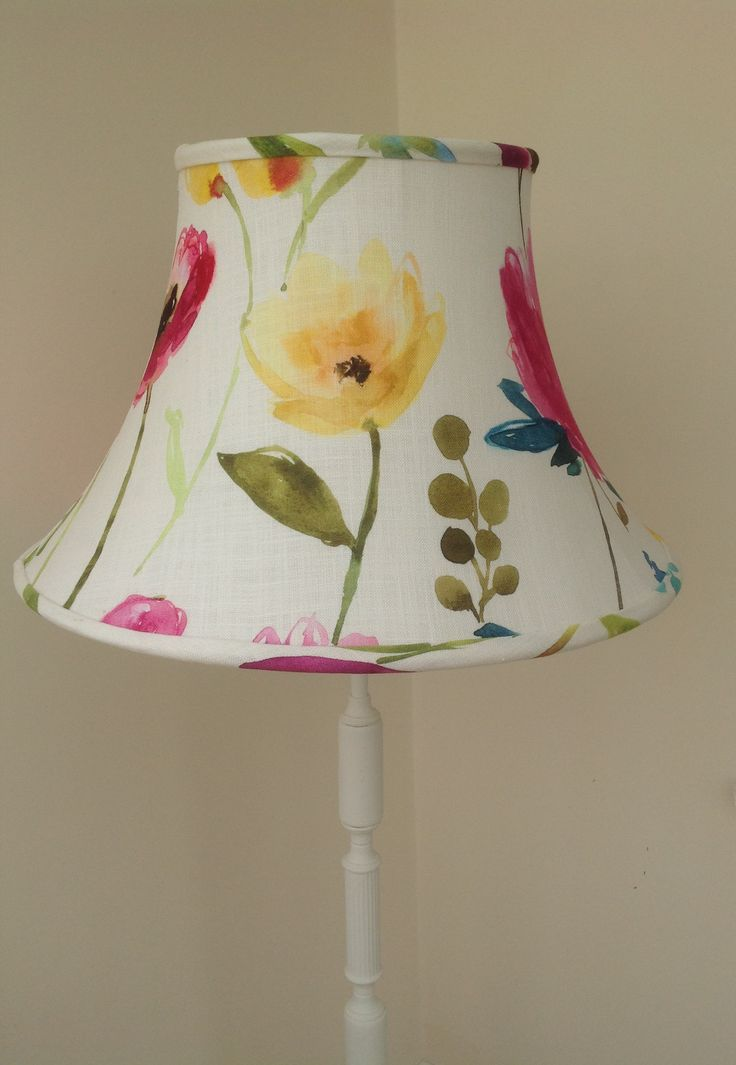 A stunning large bowed empire lampshade covered with a bluebellgray fabric called flower field ecru