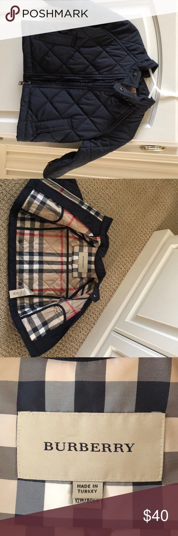 Burberry coat Infant 12 months Navy blue Burberry coat Size: Infant - 12 month Inside lining is signature Burberry print Two front pockets Front zipper, snaps at wrist and neck Wipeable and Waterproof exterior Like new, worn once for a picture Burberry Jackets & Coats