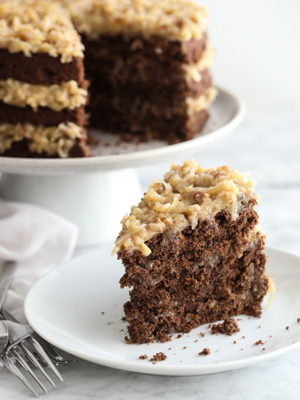 German Chocolate Cake with a decadent coconut and pecan frosting @Heidi | FoodieCrush