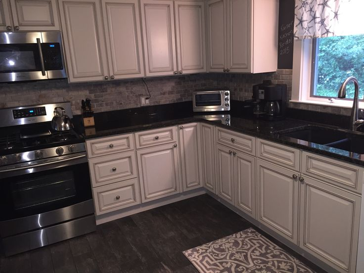 Newly Renovated Kitchen Features Include Travertine Back