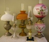 A selection of antique oil lamps