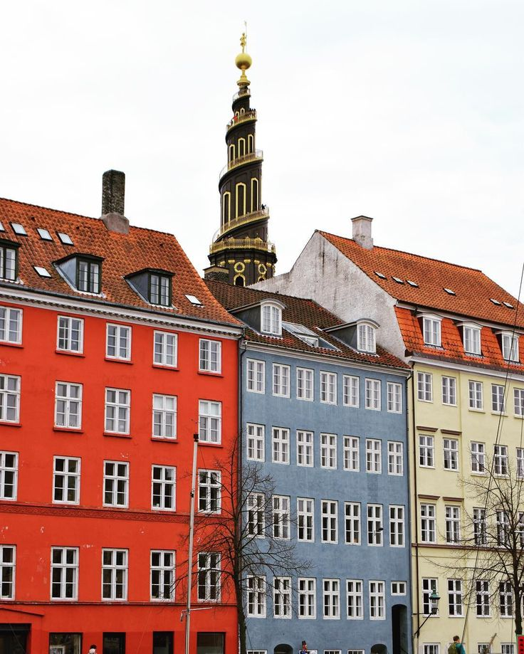 "Taken from Ovengaden Neden Vandet a canal of Christianshavn. #Christianshavn in #Copenhagen was founded in 1618 and looks a lot like the center of Amsterdam with its old houses and many canals. The buildings are amongst the oldest lasting apartment buildings in Copenhagen and the church in the background is the ""church of our savior"" with its characteristic spiraling tower in copper and gold. At the time Christianshavn was founded no one wanted to live there or build houses so the King gave…"