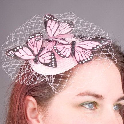 Pale-Pink Butterfly Fascinator with Veiling and Feather Butterflies in Small. £37.50, via Etsy.