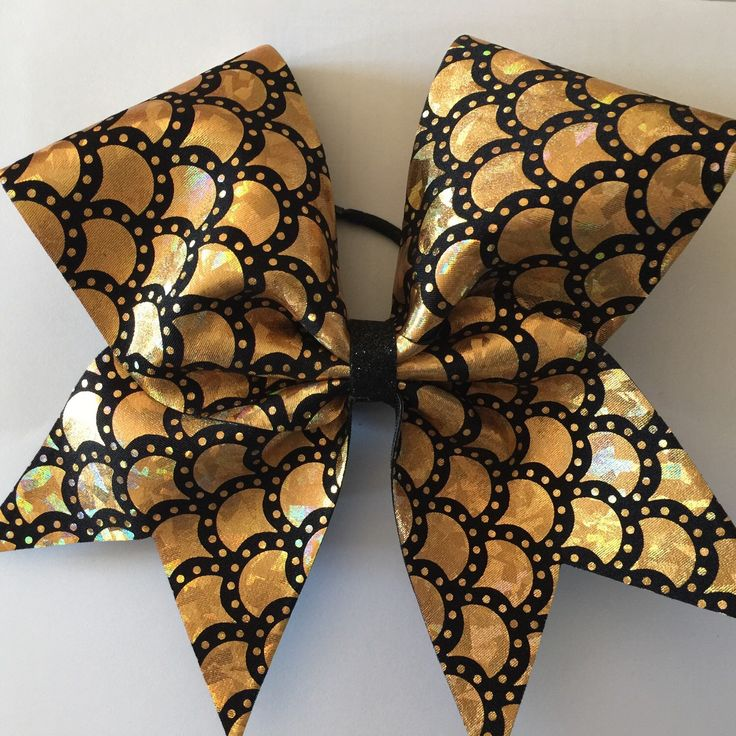 Gold and black cheer bow by CheerbowsDepot on Etsy https://www.etsy.com/listing/218344704/gold-and-black-cheer-bow