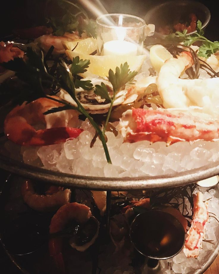 #sundaynights are meant for dim candles and tall #seafood towers. @maudesliquorbar provided both. Starting the week off right.  . . . . . . . . #chicago #resideliving #citylife #apartmentliving #cityliving #westloop #sundayvibes #eatchicago #chicagofood #chicagofoodie #foodie #lobster #shellfish