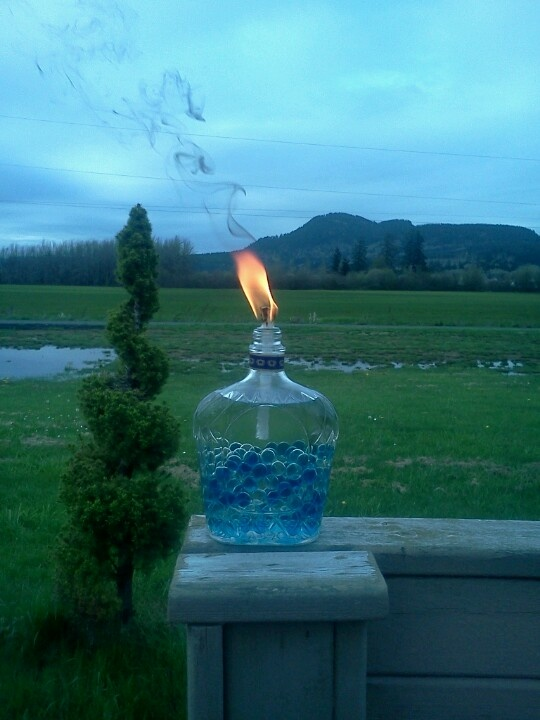"My home made tiki torches. I used Crown Royal bottles, Tiki replacement wiks, and a 3/8 washer to hold wik in place. I filled the bottles with marbles and ""OFF - Bug fighter"" tiki torch fluid. Cant wait for summer Bbq's. :D"