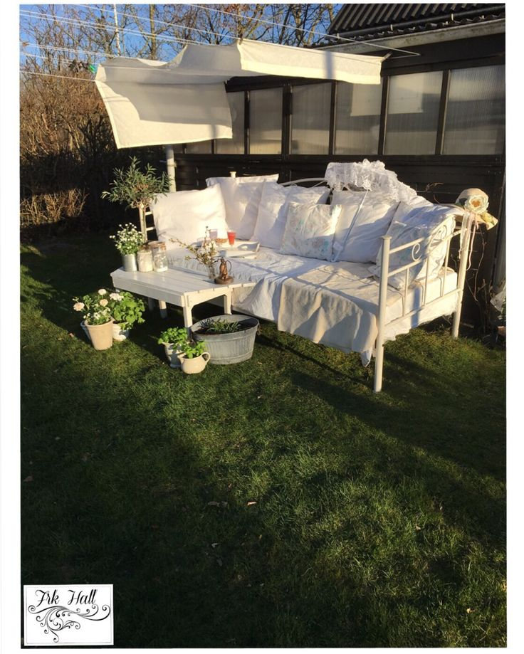 An old very beautiful romantic white shabby chic daybed in my garden