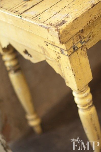 Distressed yellow table