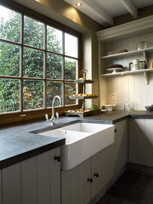 Minimalist yet slightly rustic kitchen. I love the big windows.