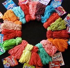 Dye wool yarn with Kool Aid.  A fun, fragrant project to do with kids you can trust to stay away from hot solutions and hot yarn.  You can use food coloring instead of Kool Aid (but won't get the nice smell), and it also works on silk fabric.