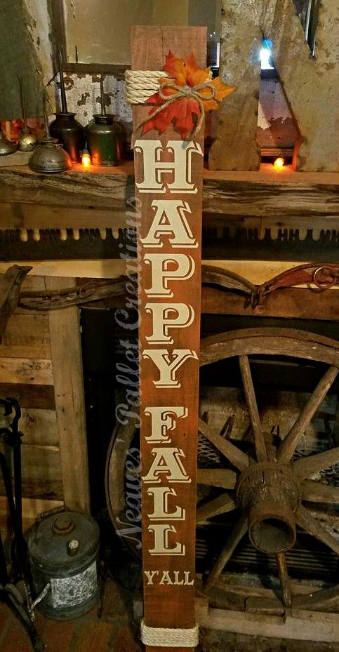 """RECYCLED PALLET WOOD: This is an unclaimed Outdoor """"Happy Fall Y'all"""" sign for your porch or any place you want to add a little color of the season. It is 64"""" tall x 5.5"""" wide, has a background color of spice orange with cream text. The text color matches the wrapped sisal rope on both the top and bottom of the sign. The """"Happy Fall Y'all"""" sign has a poly coat on the top to help protect it from the outdoor elements. We are asking $34 for the sign. Message us   Item# 1,472"""