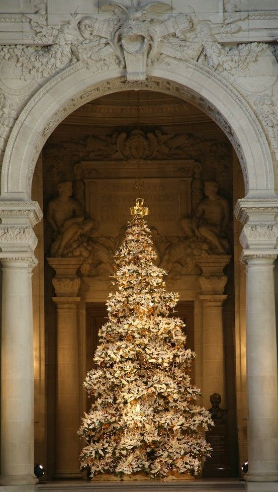 (via Christmas Joy / 2011 World Tree of Hope - the origami cranes are filled with wishes.)
