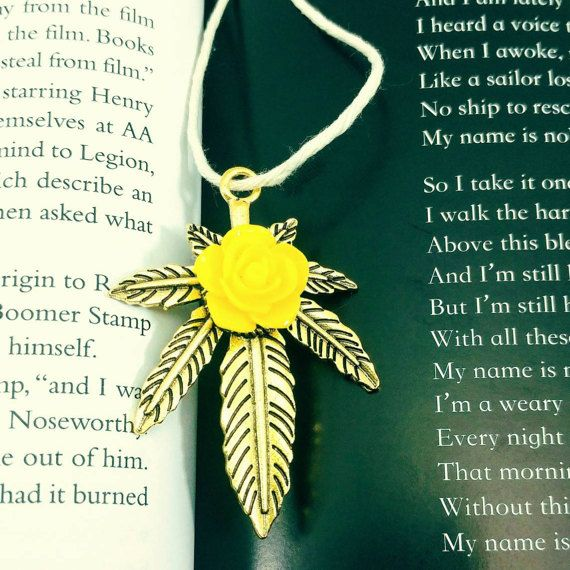 Check out this item in my Etsy shop https://www.etsy.com/listing/515172529/cannabis-leaf-with-yellow-rose-pendant