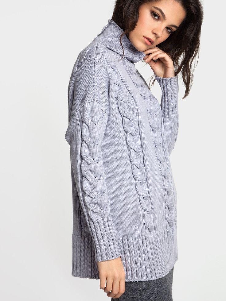 Женская коллекция. Удлиненный женский свитер с косами. Воротник - стойка, мягкая форма плеча с длинным втачным рукавом. Итальянская пряжа в виде шнурка. Сочетание хлопка с нейлоном повышает прочность и износостойкость изделия.Laplandia For Women