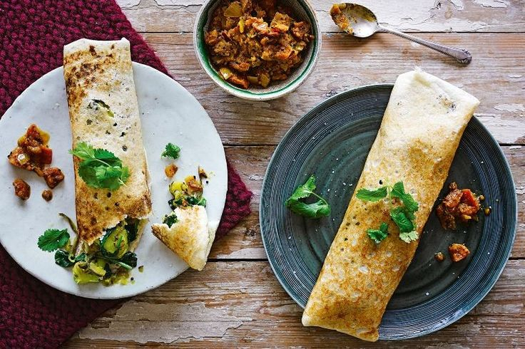 Dosa is a fine, crisp pancake. It takes a bit of time for soaking and grinding, but very little effort. Begin this recipe 2 days ahead.