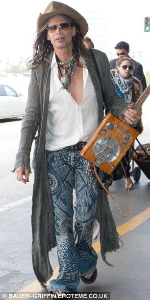 The music never stops: Steven looked ever the rocker in his ensemble and uke in hand. #ukulele