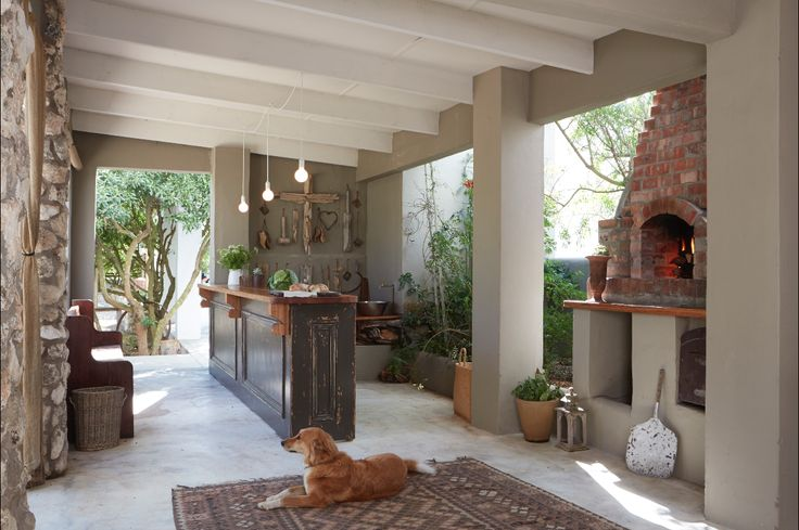 By Simone Borcherding stylist   writer   spacemaker. Clay brick pizza oven, kleim, bar, concrete screed floors and hessian curtains.