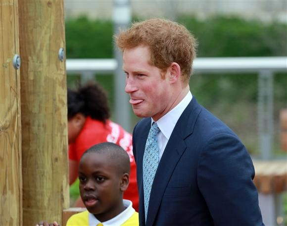 Prince Harry sticks his tongue out during a tour of the Queen Elizabeth Olympic Park in London on 04.04.14