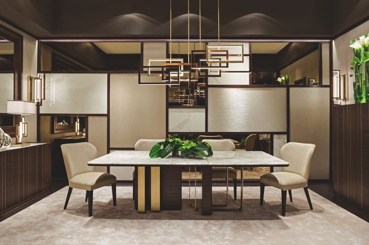 "The ""Symphony in Beige"" dining room by Oasis features a big table, Saint-Germain, with marble top and a sculpture-like base, by bronze and Bolivar wood; Frances dining chairs and Godot cupboards. The light is provided with a big Edge  suspension lamp."