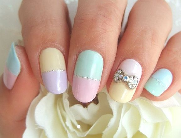 Pastel Nail Art.....I lOve the bOw on the accent nail.