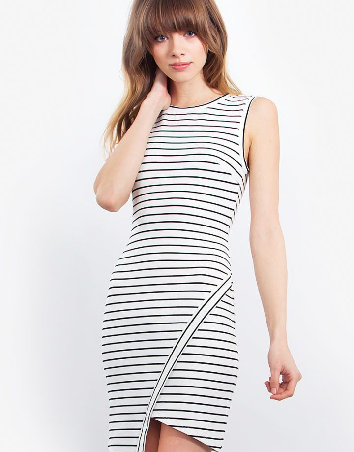 Sophisticated stripe body con dress. Looks cute paired with strappy heels and a clutch.  – Body con stripe dress – Asymmetrical hem – Knit – Zipper closure  Size + Fit – Model is wearing size S – Measurements taken from size S – Length: 33.