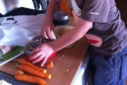 Preparing the carrots for a yummy carrot and apple salad with maple syrup dressing!