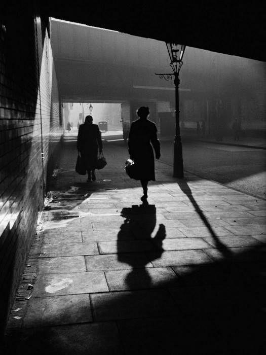 Women walking down sidewalk at night london finsbury park photo alex dellow