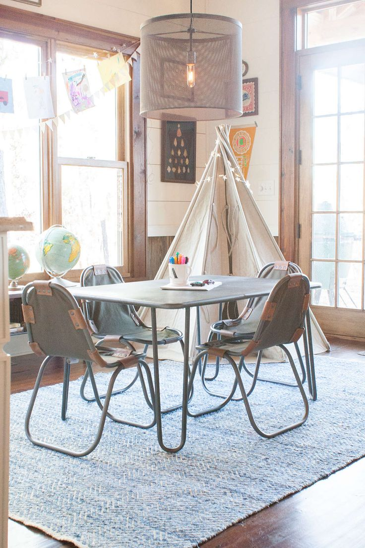 lay baby lay south georgia farmhouse playspace reveal. featuring our l'ecole adjustable play table, pascal camp play chairs, zigzag weathered denim rug, fordson steel pendant and distressed canvas surplus play tent.